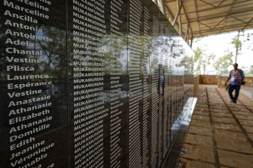"FILE - In this Friday, April 5, 2019 file photo, the names of those who were slaughtered as they sought refuge in the church, many with the same surname indicating a family, are written on a memorial to the thousands who were killed in and around the Catholic church during the 1994 genocide, outside the church in Ntarama, Rwanda. France's role before and during 1994's Rwandan genocide was a ""monumental failure"" that the country must face, the lead author of a sweeping report commissioned by President Emmanuel Macron said, as the country is about to open its archives from this period for the first time to the broader public."