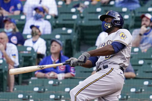 Milwaukee Brewers' Lorenzo Cain watches after hitting a three-run home run against the Chicago Cubs during the 10th inning of a baseball game in Chicago, Wednesday, April 7, 2021.