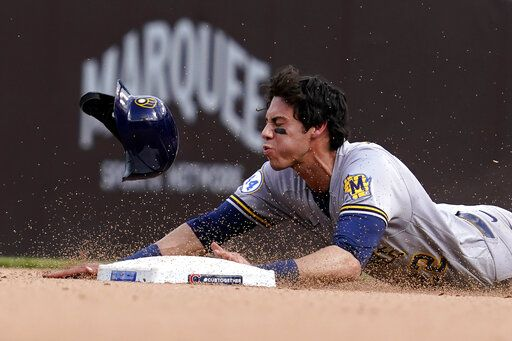 Milwaukee Brewers' Christian Yelich steals second base during the eighth inning of a baseball game against the Chicago Cubs in Chicago, Wednesday, April 7, 2021.