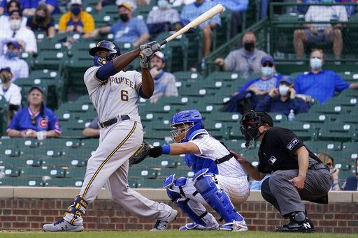 Milwaukee Brewers' Lorenzo Cain hits a three-run home run against the Chicago Cubs during the 10th inning of a baseball game in Chicago, Wednesday, April 7, 2021.