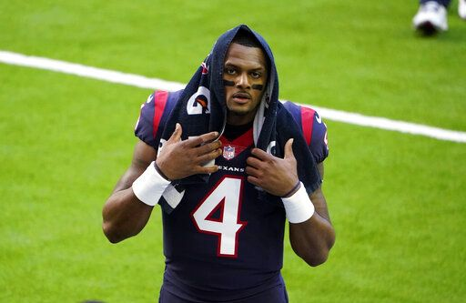 FILE - In this Jan. 3, 2021, file photo, Houston Texans quarterback Deshaun Watson walks off the field before the team's NFL football game against the Tennessee Titans in Houston. Watson, who is accused of sexual assault and harassment in lawsuits filed by 21 women, is being investigated by police after a report was filed regarding the NFL player, officials said Friday, April 2. In a tweet Friday, the Houston Police Department said a complainant had filed a report with the agency about Watson.