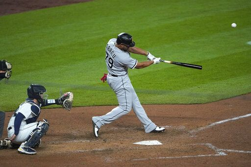 Chicago White Sox's Jose Abreu hits a grand slam during the eighth inning of the team's baseball game against the Seattle Mariners, Tuesday, April 6, 2021, in Seattle.