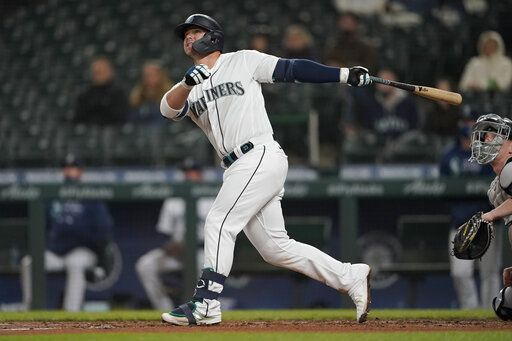 Seattle Mariners' Ty France watches his RBI double during the third inning of the team's baseball game against the Chicago White Sox, Tuesday, April 6, 2021, in Seattle.