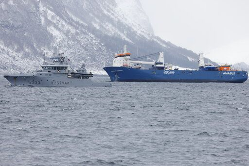 The Dutch cargo ship Eemslift Hendrika is guided to land at Alesund, Norway, Thursday April 8, 2021. Despite heavy seas, a joint Norwegian-Dutch salvage operation has managed to get the abandoned Dutch cargo ship under control off the coast of Norway and towing it to port. Svein Ove Ekornesvåg / NTB