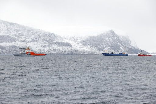 The Dutch cargo ship Eemslift Hendrika, 2nd right, is guided to land at Alesund, Norway, Thursday April 8, 2021. Despite heavy seas, a joint Norwegian-Dutch salvage operation has managed to get the abandoned Dutch cargo ship under control off the coast of Norway and towing it to port. Svein Ove Ekornesvåg / NTB