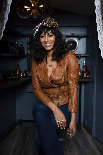 "Two-time Grammy nominee Keri Hilson poses for a portrait in Atlanta on March 31, 2021 to promote her upcoming TV movie 'œLust: A Deadly Sins Story,"" premiering Saturday on Lifetime. (Photo by Paul R. Giunta/Invision/AP)"