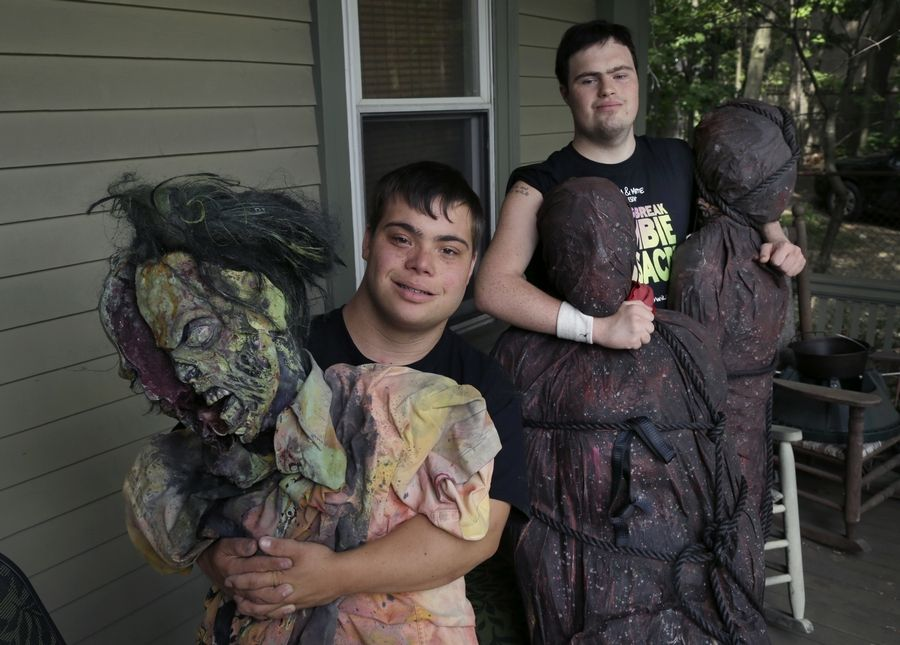 "Mattie Zufelt, left, and Sam Suchmann pose with ghoulish figures at Sam's home in Providence, R.I. The two young men with Down syndrome who caused a sensation four years ago when they created their own gory zombie movie are back, this time in the documentary ""Sam & Mattie Make a Zombie Movie,"" which was released Tuesday on Apple TV."