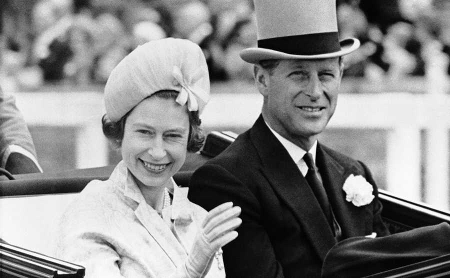 In this June 19, 1962 file photo, Britain's Queen Elizabeth II and Prince Philip travel by open carriage around the track prior to the race program, at Ascot, England. Prince Philip was the longest serving royal consort in British history. In Britain, the husband or wife of the monarch is known as consort, a position that carries immense prestige but has no constitutional role.