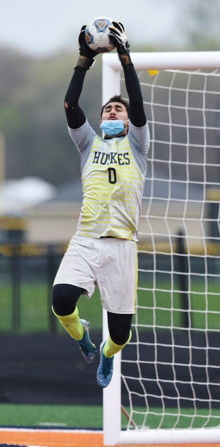 Naperville North goalkeeper Pablo Jara leaps for a save.
