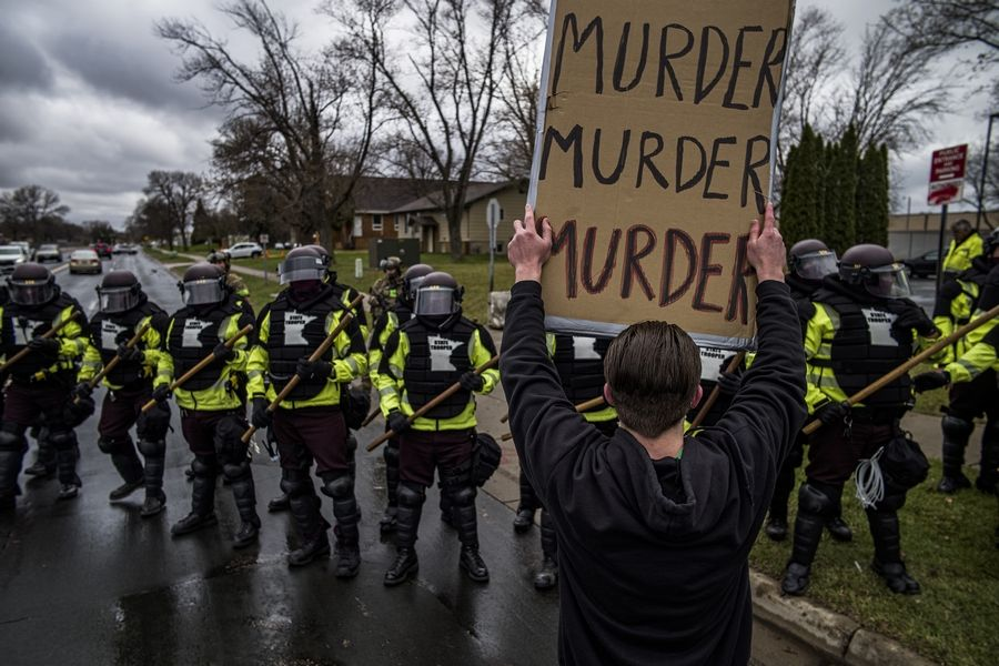 Protesters confront police Monday over the shooting death of Daunte Wright in Brooklyn Center, Minnesota.