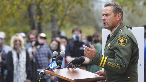 San Luis Obispo County Sheriff Ian Parkinson answers questions at a press conference in San Luis Obispo, Calif., Tuesday, April 13, 2021, on arrests connected to the disappearance of Kristin Smart.   (David Middlecamp/The Tribune (of San Luis Obispo) via AP)