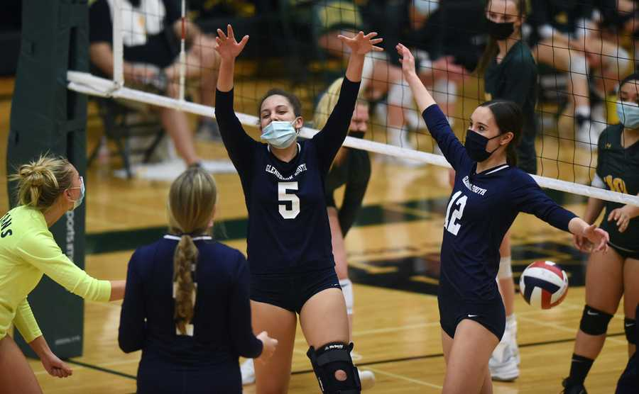 Glenbrook South's Sammi Klemm (5) and Caroline Crawford (12) celebrate with their teammates as they close in on victory during Wednesday's match against Glenbrook North. The Titans won 2-1, with scores of 26-24, 28-30, 25-21.
