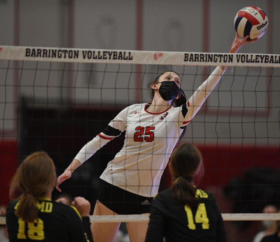 Barrington's Campbell Paris tries to lift the ball over the net against Fremd in a girls volleyball match in Barrington Wednesday.