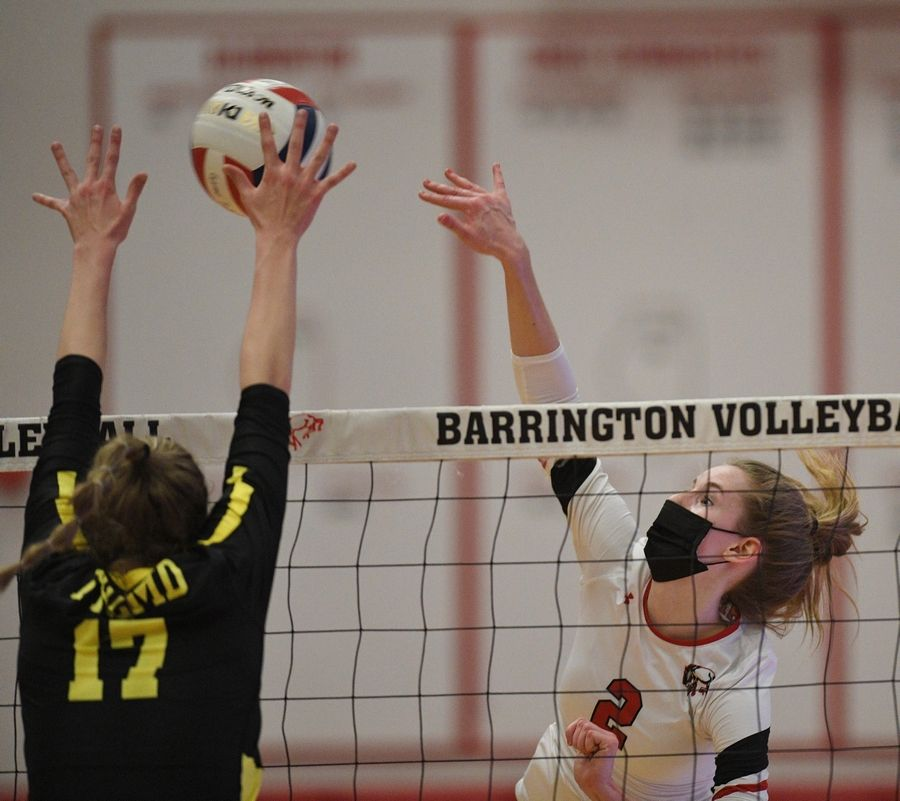 Barrington's Jessica Horwath hits past Fremd's Rian Baker in a girls volleyball match in Barrington Wednesday, April 14, 2021.