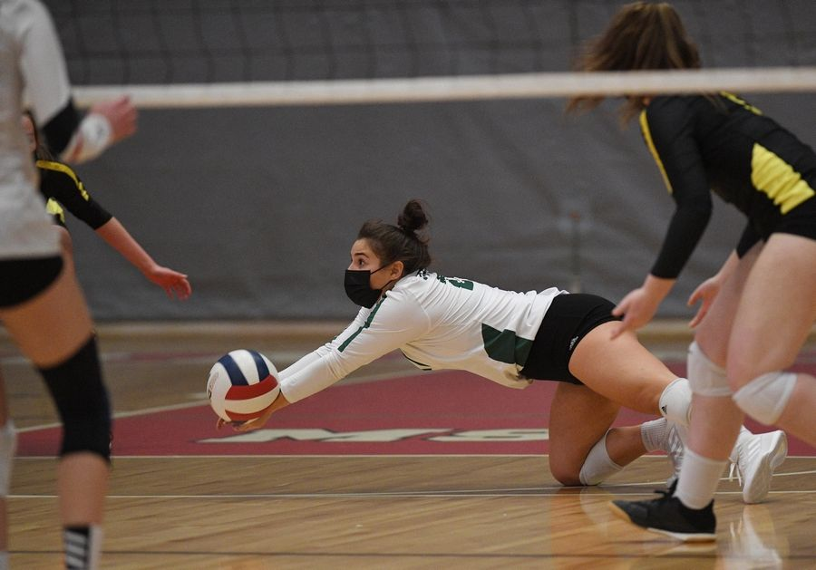 Fremd's Izzy Segoviano dives to save a back row shot by Barrington in a girls volleyball match in Barrington Wednesday, April 14, 2021.