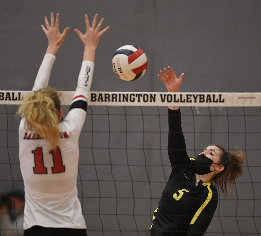 Fremd's Sarah Graham hits into the defense of Barrington's Jenna Meitzler in a girls volleyball match in Barrington Wednesday, April 14, 2021.
