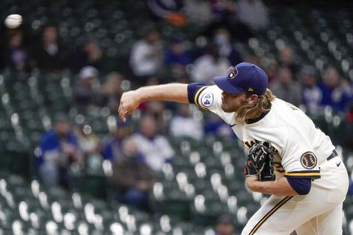 Milwaukee Brewers starting pitcher Corbin Burnes throws during the first inning of a baseball game against the Chicago Cubs Wednesday, April 14, 2021, in Milwaukee.