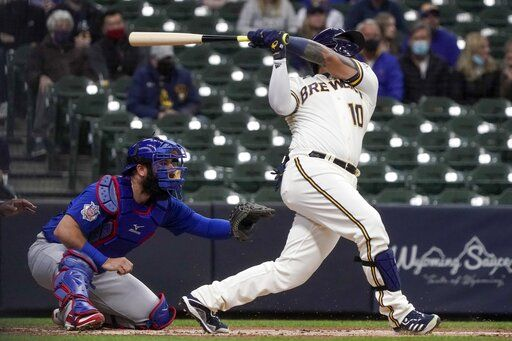 Milwaukee Brewers' Omar Narvaez hits a run-scoring sacrifice fly during the first inning of a baseball game against the Chicago Cubs Wednesday, April 14, 2021, in Milwaukee.