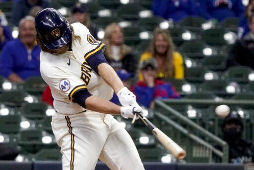 Milwaukee Brewers' Corbin Burnes hits an two-run scoring single during the sixth inning of a baseball game against the Chicago Cubs Wednesday, April 14, 2021, in Milwaukee.
