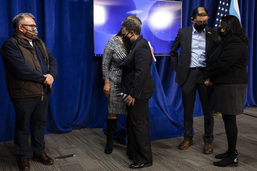 Mayor Lori Lightfoot hugs Karina Ayala-Bermejo, of Instituto Del Progreso, after discussing the videos of 13-year-old Adam Toledo, who was fatally shot by a Chicago police officer, during a news conference at City Hall, Thursday.