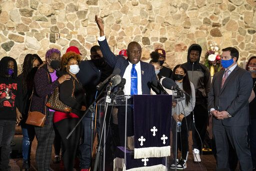 Attorney Ben Crump speaks alongside members of the deceased Daunte Wright's family during a news conference at New Salem Missionary Baptist Church, Thursday, April 15, 2021, in Minneapolis.