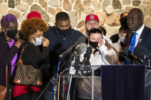 Family members of the deceased Daunte Wright, from left, Angie Golson, grandmother, Naisha Wright, aunt, Aubrey Wright, father, Katie Wright, mother, and the family's attorney Ben Crump, right, attend a news conference at New Salem Missionary Baptist Church, Thursday, April 15, 2021, in Minneapolis.