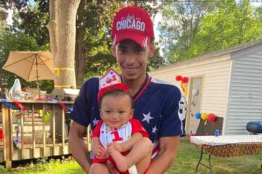 FILE - This photo provided by Ben Crump Law, PLLC. shows Daunte Wright and his son, Daunte Jr., at his first birthday party. Wright, 20, was killed during a traffic stop by a white suburban Minneapolis police officer on Sunday, April 11, 2021. (Ben Crump Law, PLLC. via AP)