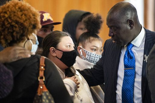 Katie Wright, mother of Duante Wright, speaks with attorney Ben Crump, right, during a news conference at New Salem Missionary Baptist Church, Thursday, April 15, 2021, in Minneapolis.