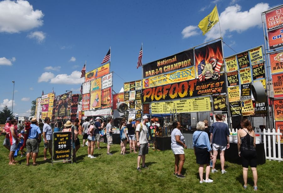 Patrons lined up for barbecue during Ribfest in Naperville two years ago. This year's event will be in Romeoville, and social distancing will be a top priority.