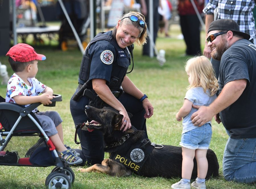 Buffalo Grove Days will be a modified block party this year, organizers said. This is Buffalo Grove police Officer Danielle Baron and police dog Hogyn at the event two years ago.