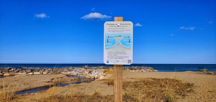 "A sign warns of rip currents at Rosewood Beach in Highland Park. ""Yes, it's a lake, (but) treat it more like an ocean,"" said Lt. Junior Grade Phillip Gurtler of the U.S. Coast Guard."