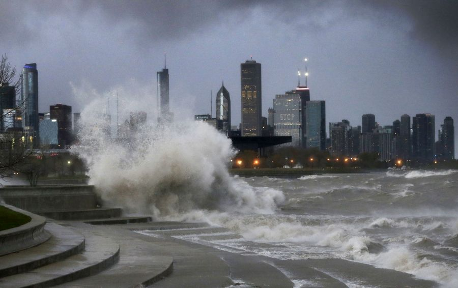 High winds that create large waves, like these crashing along a Lake Michigan retaining wall at Chicago's 31st Street Beach, can make rip currents fast and dangerous.