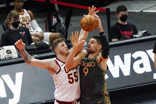 Chicago Bulls center Nikola Vucevic, right, drives to the basket against Cleveland Cavaliers center Isaiah Hartenstein during the second half of an NBA basketball game in Chicago, Saturday, April 17, 2021.