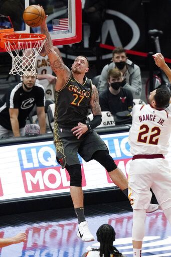 Chicago Bulls center Daniel Theis dunks against Cleveland Cavaliers forward Larry Nance Jr. during the second half of an NBA basketball game in Chicago, Saturday, April 17, 2021.