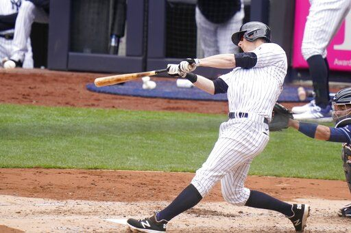 New York Yankees' DJ LeMahieu hits an RBI single during the second inning of a baseball game against the Tampa Bay Rays, Saturday, April 17, 2021, in New York.