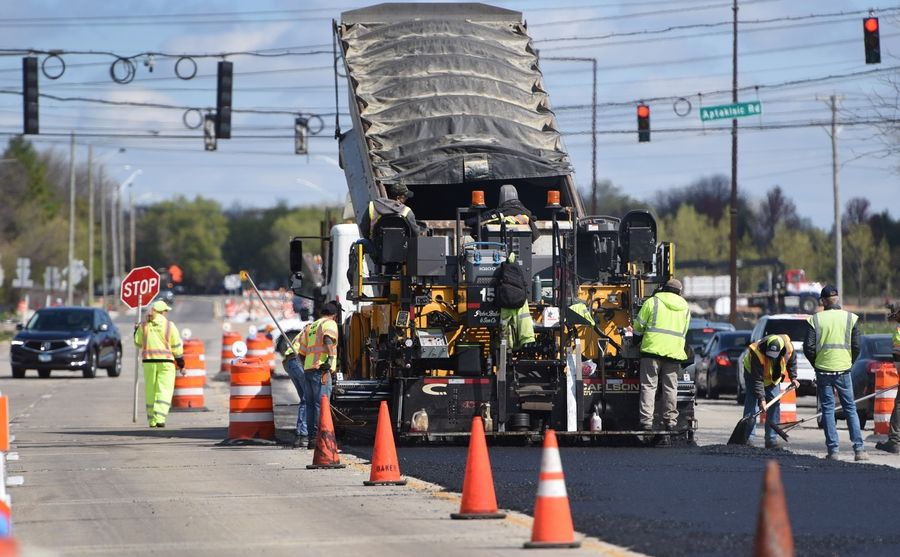 Work crews fix a section of Buffalo Grove Road just south of Aptakisic Road in Buffalo Grove on Friday. Road construction and other infrastructure priorities are part of the $2 trillion American Jobs Plan President Joe Biden is promoting.