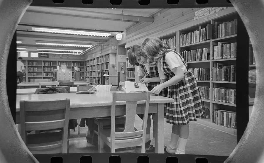 The Daily Herald Archive, Assignment # 387, Tom Grieger photo: These two girls look through books in the children's section of the Arlington Heights Library in February of 1965.