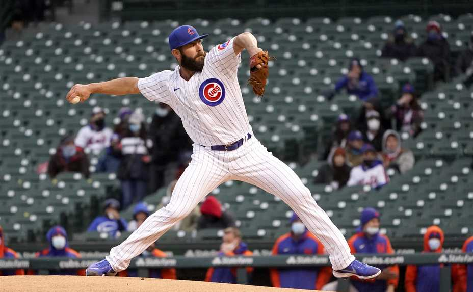 Chicago Cubs starting pitcher Jake Arrieta delivers during the first inning of the team's baseball game against the New York Mets on Tuesday, April 20, 2021, in Chicago.