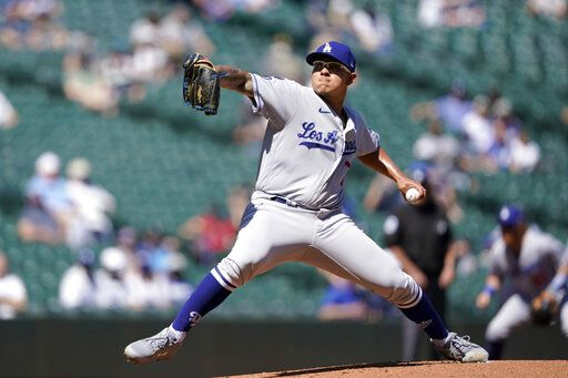 Los Angeles Dodgers starting pitcher Julio Urias throws against the Seattle Mariners in the first inning of a baseball game Tuesday, April 20, 2021, in Seattle.