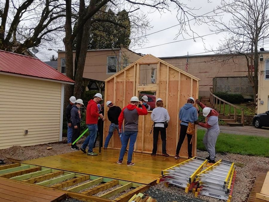 Thirty-five students from Batavia High School's Building Trades II classes put up two Boardwalk Shops April 9 in downtown Batavia.