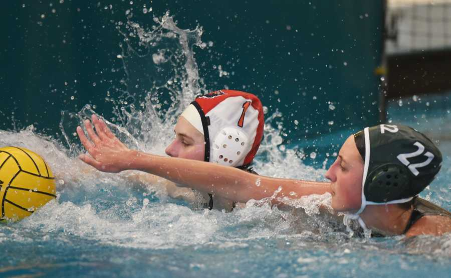 Glenbrook North's Julia Gehrs, right, pressures Evanston goalie Nina Kaiser in front of the net during Thursday's girls water polo game in Northbrook.