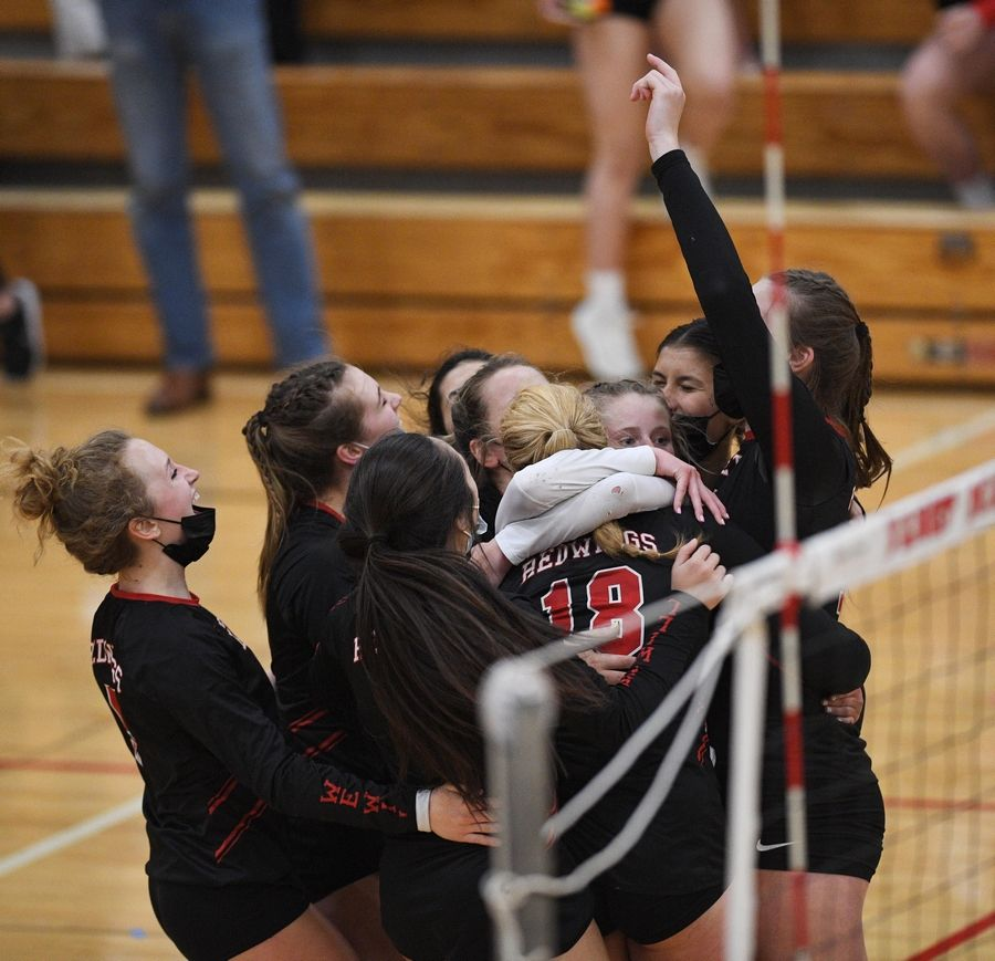 Benet celebrates its East Suburban Catholic Conference tournament championship win over Marist Wednesday in Lisle.