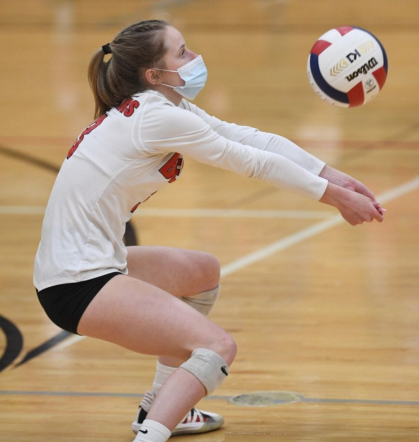 Benet Academy's Caroline Doyle digs a shot against Marist in the East Suburban Catholic Conference girls volleyball tournament championship match Wednesday, April 21, 2021.