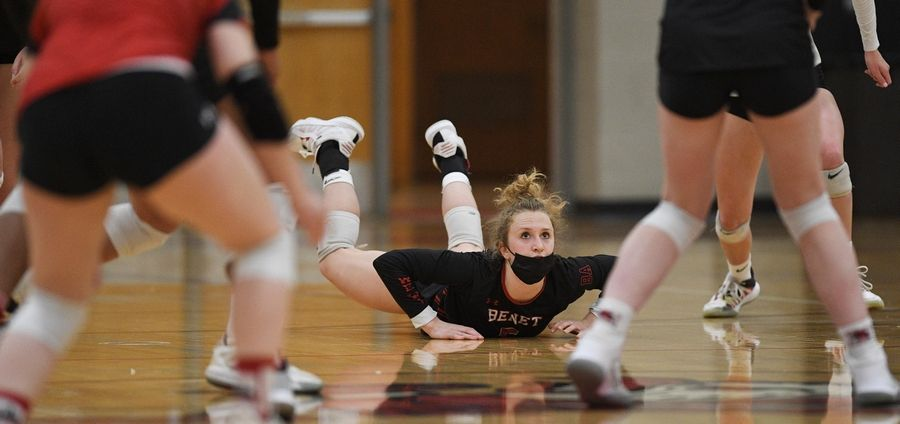 Benet Academy's Jaclynn Budreck watches from the floor after diving for a back row shot from Marist in the East Suburban Catholic Conference girls volleyball tournament championship match Wednesday, April 21, 2021.