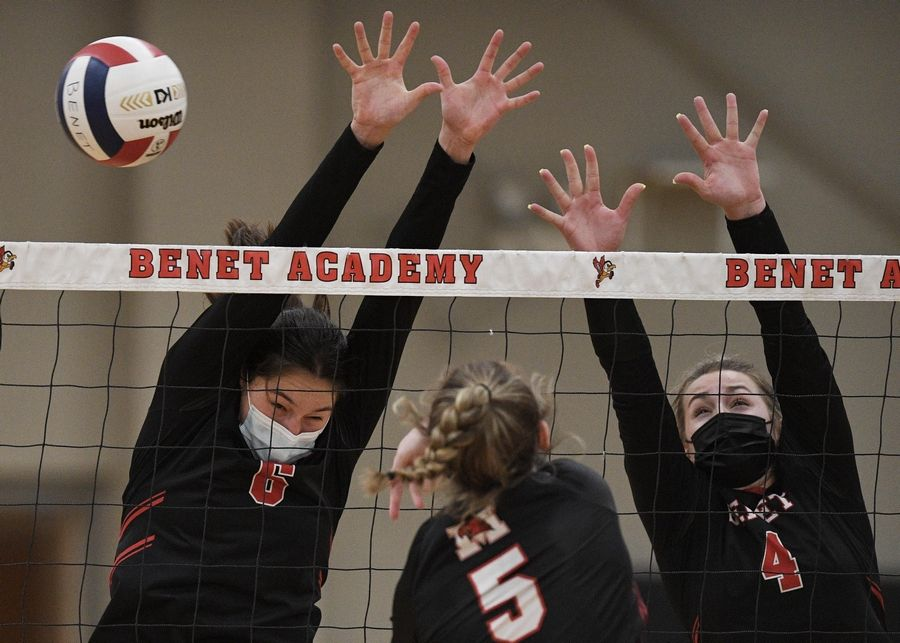 Benet Academy's Ann Marie Remmes and Kyla Kenney can't stop a shot by Marist's Mary Clare Brusek in the East Suburban Catholic Conference girls volleyball tournament championship match Wednesday, April 21, 2021.
