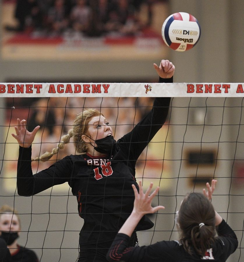 Benet Academy's Rachel Muisenga taps the ball over the net against Marist in the East Suburban Catholic Conference girls volleyball tournament championship match Wednesday, April 21, 2021.
