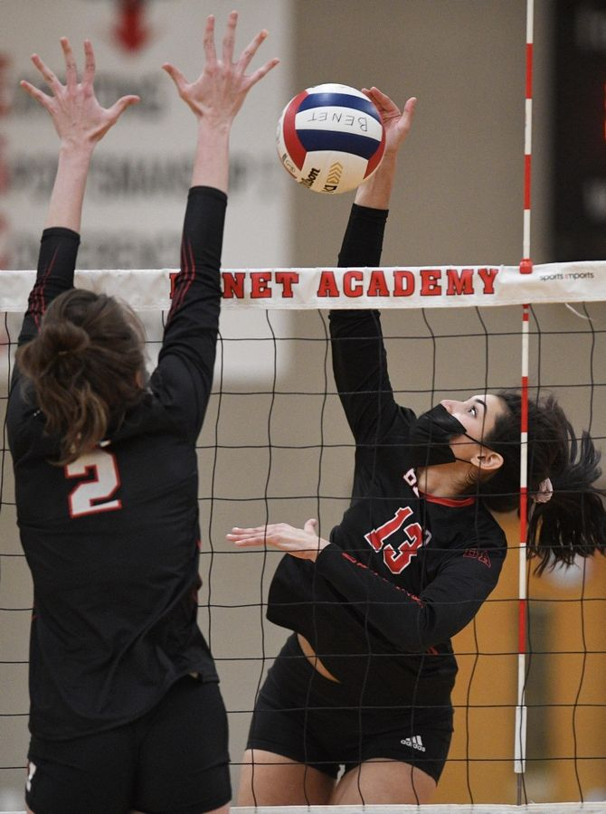 Benet Academy's Daria Rodriquez hits against Marist's Elise Ward in the East Suburban Catholic Conference girls volleyball tournament championship match Wednesday, April 21, 2021.