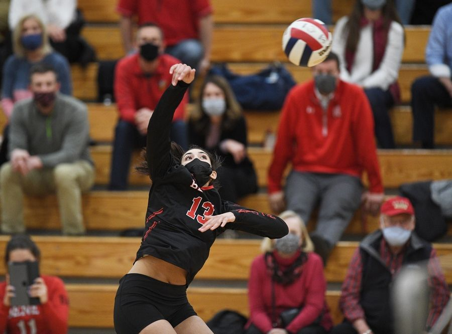 Benet Academy's Daria Rodriquez hits against Marist in the East Suburban Catholic Conference girls volleyball tournament championship match Wednesday, April 21, 2021.