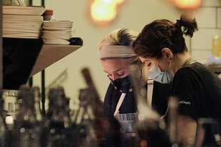 Scratchboard Kitchen Executive Chef Grace Goudie, left, creates courses last month for a special dinner series called Recipe for Empowerment.