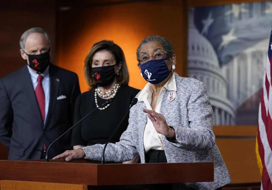 Del. Eleanor Holmes-Norton, a Washington D.C. Democrat, center, joined from left by Sen. Tom Carper, a Delaware Democrat, and House speaker Nancy Pelosi, a California Democrat, speaks at a news conference ahead of the House vote on H.R. 51- the Washington, D.C. Admission Act.